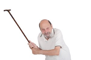 old man holding a cane and scolding