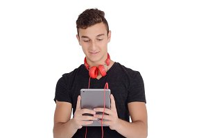 Happy teenage boy using tablet with