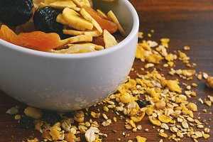 Bowl with different dried fruits on