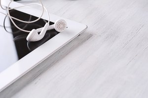 Close up of tablet with earphones on