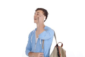 Young latin man with backpack using
