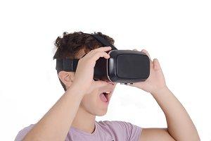 Joyful teen boy using VR goggles