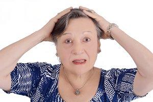Portrait of elderly woman shocked