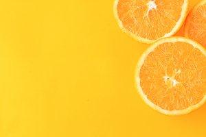 Close up of orange slices on yellow