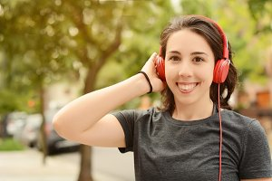 Beautiful woman with red headphones