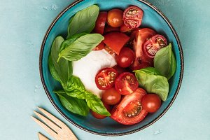 Caprese salad on blue background