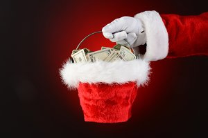 Santa Claus Holding a Bucket of Cash
