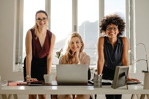 Multiracial businesswomen in office