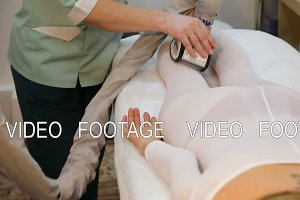 Therapist applying lipo massage.