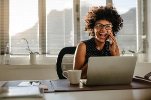 Laughing businesswoman sitting