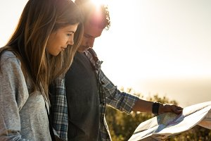 Tourist couple using a map