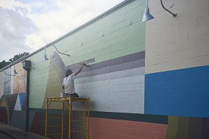 Man Painting a Mural