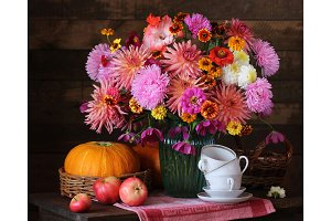Autumn still life with flowers and f