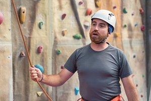Man climber preparing to climb