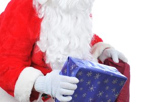 Santa Claus Putting Present in Bag