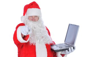 Santa Claus Holding Laptop Pointing