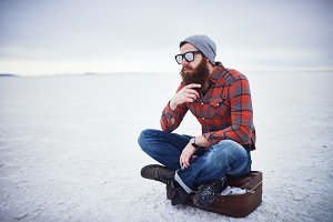 lost hipster stroking beard