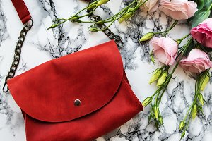 Red leather bag and flowers
