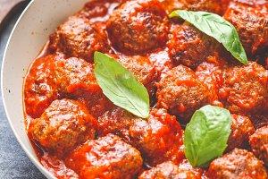 Tasty beef meatballs in tomato sauce