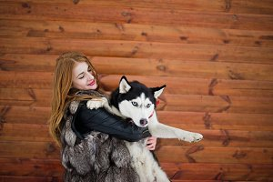 Red haired girl with husky dog again