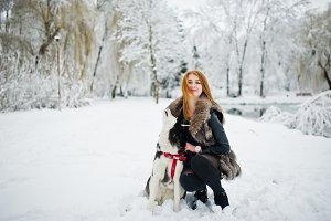 Red haired girl walking at park with