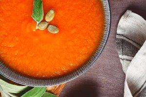 Season pumpkin creamy soup with sage