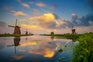 Sunset above old dutch windmills