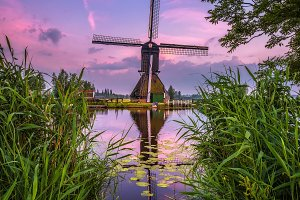 Old dutch windmill at sunset