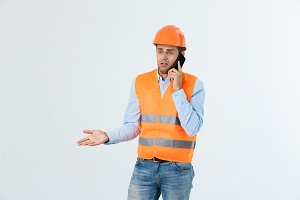Construction engineer talking on