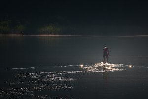 Young man on a sup in the early morn