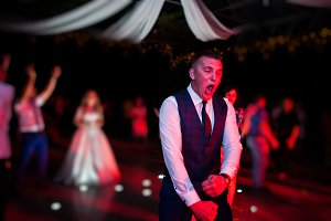 Happy crazy dance of groom at weddin