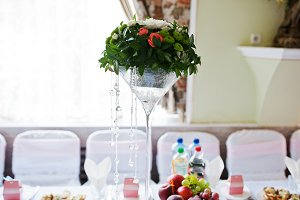 Vase with flowers at wedding tables