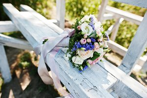 Elegant wedding bouquet at white woo