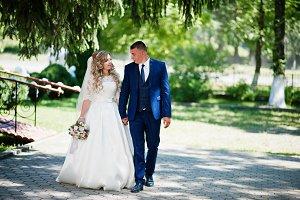 Happy wedding couple in love near sm