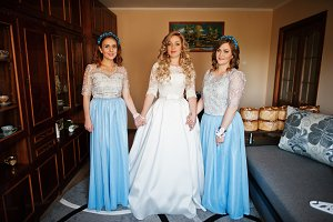Bridesmaids and bride preparing at r