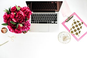 Home office desk with peonies