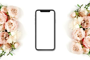 Smartphone in frame of roses