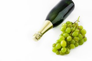 Champagne bottle and grapes