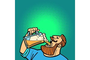 Bearded man drinking a mug of beer