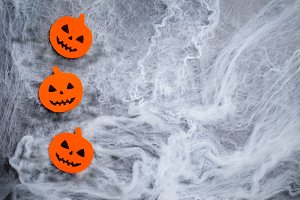 Pumpkin Heads on Cobweb Background,