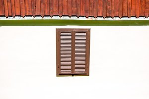 Window with closed wooden jalousie
