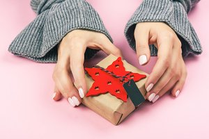 Female hands holdin gift box