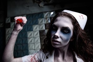 Scary evil insane zombie nurse