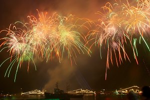 Colorful fireworks above water