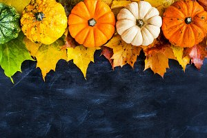 Autumnal colorful pumpkins, apples a