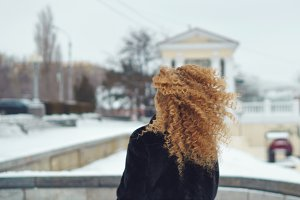 Red-haired girl outdoors in winter