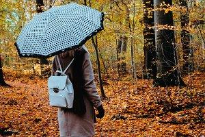 Female with rotate white umbrella in