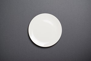 Empty White Plate, Top View on Grey