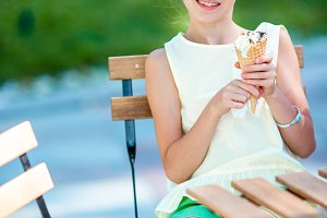 Little girl eating ice-cream outdoor