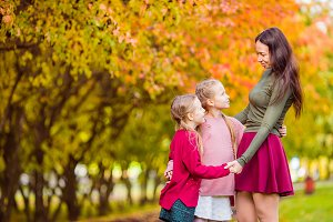 Little girl with mom outdoors in par